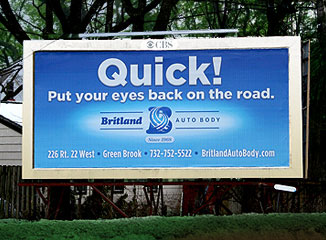 Billboards like this can be located opposite traffic light for an auto body shop