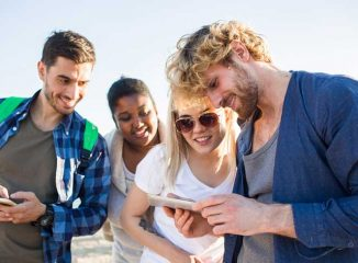 Millennial Marketing reaches customers like these people looking at a smartphone together