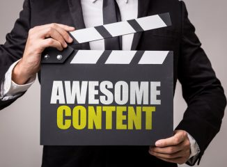 Improve Cornerstone Content blog photo of man holding clapboard that says Awesome Content