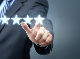 Online Reviews Build Trust and Traffic. 5 Stars being selected by a man in a business suit.