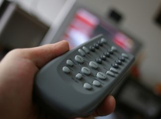 Remote control to watch television, including commercials by national advertisers